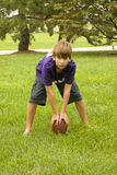 Boy Holding Football stock image