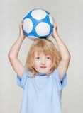 Boy holding football Royalty Free Stock Photography