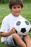 Boy holding football. Little boy holding a football Royalty Free Stock Photography