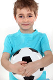 Boy holding a football ball Royalty Free Stock Photo