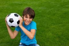 Boy holding football ball Royalty Free Stock Image