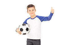 Boy holding a football and giving a thumb up Stock Image