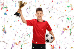 Boy holding a football and a trophy Stock Images