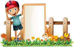 A boy holding a framed empty banner with a rabbit Stock Images