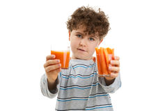 Boy holding fresh carrots Stock Photos