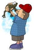 Boy holding a frog. This illustration that I created depicts a boy holding up a frog Royalty Free Stock Photography
