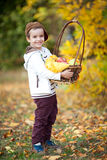 A boy holding fruit basket, smiling Royalty Free Stock Photo