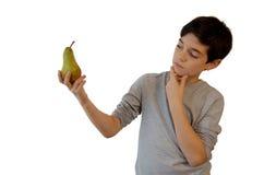 Boy holding a fruit Stock Image