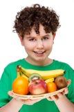 Boy holding fruits. Isolated on white background Stock Image