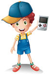 A boy holding a gameboy. Illustration of a boy holding a gameboy on a white background Royalty Free Stock Photography