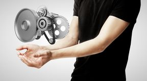 Boy holding gears Royalty Free Stock Image