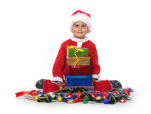Boy holding a gift Stock Images