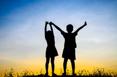 Boy holding girl hand for climbing higher Royalty Free Stock Photography
