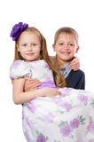 Boy is holding the girl in his arms Royalty Free Stock Photo