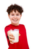 Boy holding glass of milk Stock Images