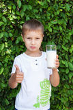 Boy holding a glass of milk Stock Photo