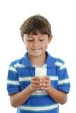 Boy holding glass of milk Royalty Free Stock Images