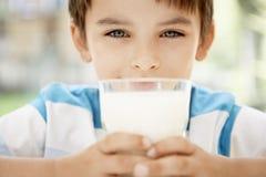 Boy Holding Glass Of Milk Royalty Free Stock Photos