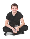 Boy holding glass of water Royalty Free Stock Photos
