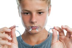 Boy holding glasses in front of face. Royalty Free Stock Photos