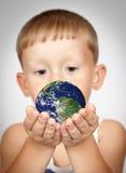 A boy holding a globe Stock Image