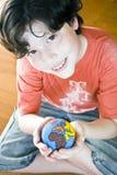 Boy holding a Globe. Globe on child hands, close-up royalty free stock photos