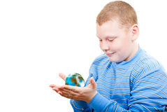 Boy holding a globe in the form of the planet. On a white background Royalty Free Stock Photo