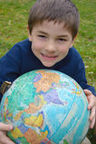Boy Holding Globe royalty free stock photo