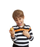 Boy holding a golden egg Stock Images