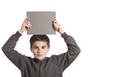 Boy holding a gray card Stock Image