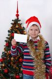 Boy holding greeting card. Christmastime Royalty Free Stock Photos
