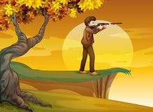 A boy holding a gun near the tree Royalty Free Stock Photos