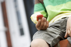 Boy Holding Half Eaten Apple Stock Photography
