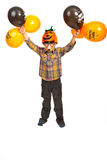 Boy holding Halloween balloons. Boy with pumpkin hat and mask holding Halloween balloons isolated on white background Royalty Free Stock Photos