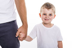 Boy holding hands of his father standing against white background. A Boy holding hands of his father standing against white background stock photos