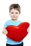 Boy holding heart Stock Images