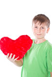 Boy holding a heart Royalty Free Stock Photography