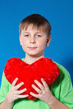 Boy holding a heart Stock Photography