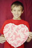 Boy Holding Heart Stock Photography