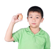 Boy holding hen egg in hand on white background isolated Royalty Free Stock Image