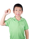 Boy holding hen egg in hand on white background isolated Royalty Free Stock Photo