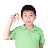 Boy holding hen egg in hand on white background isolated Stock Photos