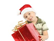 Boy  holding her Christmas present Royalty Free Stock Photos