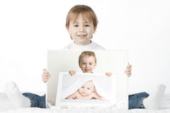 Boy holding his baby photos royalty free stock photo