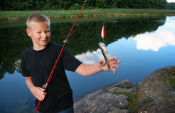 Boy holding his catch Royalty Free Stock Photography