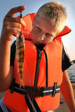 Boy holding his catch of the day Stock Image