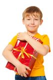 Boy holding his Christmas present Stock Image