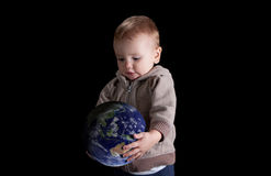 Boy holding his future world in his hands Royalty Free Stock Photography