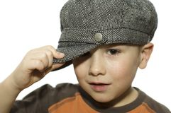 Boy holding his hat. Six year old holding his hat. On white background stock images