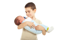 Boy holding his newborn brother Royalty Free Stock Photos